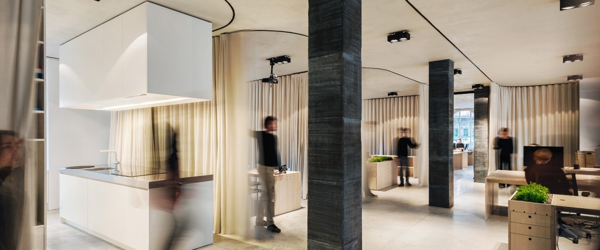 Changing the acoustics of a working space using acoustic fabrics